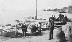 P379d Gilyaks with their boats at Khabarovsk.jpg