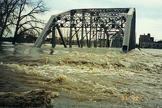 Climate of Minnesota - A bridge connecting East Grand Forks, Minnesota, to Grand Forks, North Dakota, during the record flooding of the Red River in 1997.