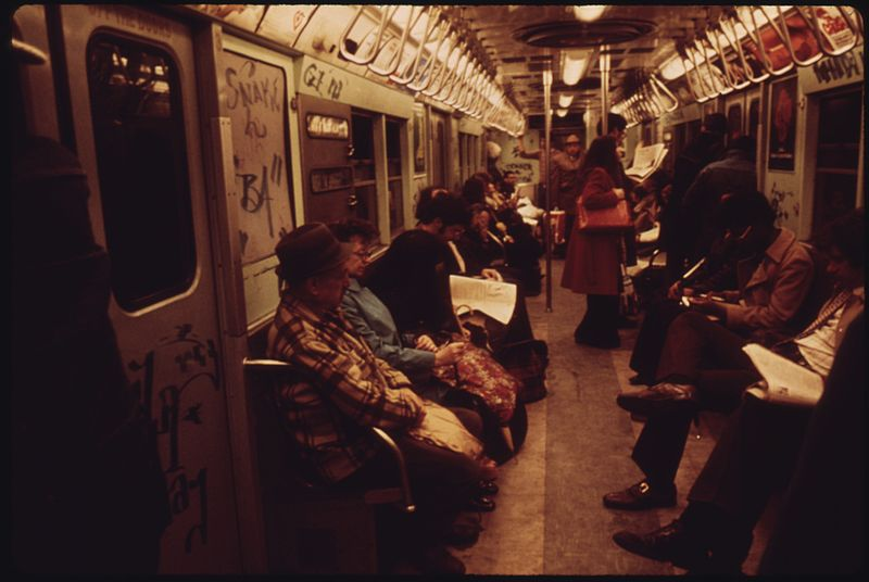 File:PASSENGERS ABOARD THE NEW YORK CITY TRANSIT AUTHORITY SUBWAY ON THE LEXINGTON AVENUE LINE ARE OBLIVIOUS TO THE... - NARA - 556653.jpg