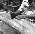 Palauan Storyboard Carving at work 1.jpg