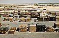 Pallets and containers of equipment sit in a logistics support area during Operation Desert Shield.jpg