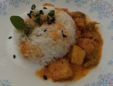 Paneer Curry with chaunk (containing vegetable oil, cumin seeds, green chilies) on rice.