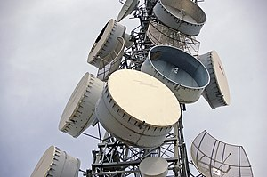 Parabolic antenna - Shrouded microwave relay dishes on a communications tower in Australia.