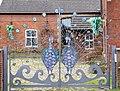 Peacock gates 1 (3333111318).jpg