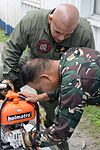 Philippine Airmen and US Marines train on aircraft crash fire rescue equipment 140506-F-YO331-002.jpg
