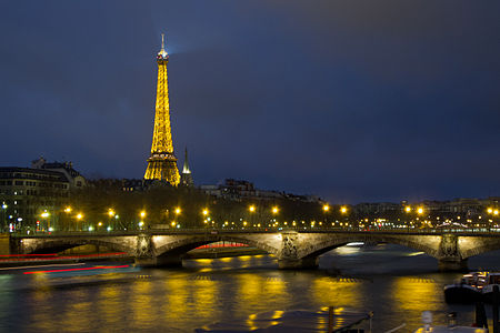 Night view of Eiffel Tower and Pont des Invalides, Paris