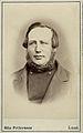 Porträtt på en man, bröstbild. Östra Espinge, Frosta härad, Skåne - Nordiska Museet - NMA.0042834.jpg