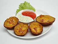 Potato skins arranged on a plate as an appetizer.jpg