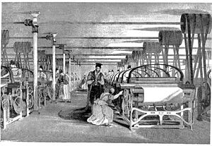 Industrial Revolution - A Roberts loom in a weaving shed in 1835. Textiles were the leading industry of the Industrial Revolution and mechanized factories, powered by a central water wheel or steam engine,  were the new workplace.