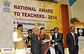 Pranab Mukherjee presenting the National Award for Teachers-2014 to Shri Sanjay Kumar Maithil, Chhattisgarh, on the occasion of the 'Teachers Day', in New Delhi. The Union Minister for Human Resource Development.jpg