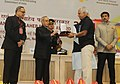 """Pranab Mukherjee presenting the Rajat Kamal Award for Best Arts & Cultural Film """"Kapila"""" & Best Biographical Film """"Aamaar Katha Story of Binodini"""" in Non Feature Films Section to the Producer, Films Division.jpg"""