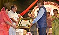 Pranab Mukherjee presenting the first Bhairon Singh Shekhawat Life Time Achievement Honour in Public Service to the Chief Minister of Sikkim, Shri Pawan Kumar Chamling.jpg