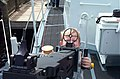 Precocious little boy aims a big fifty caliber Browning, aboard the USCGC Seahawk.jpg