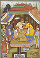 Prince Salim with a courtier and attendants in a tent.jpg