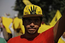 Protester wearing hat with R4bia sign in Maadi-Cairo 20-Sep-2013.jpg