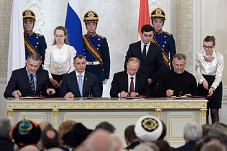 Crimean status referendum, 2014 - Vladimir Putin (third, left), Sergey Aksyonov (first, left), Vladimir Konstantinov (second, left) and Aleksei Chalyi (right) sign the Treaty on the Adoption of the Republic of Crimea to Russia