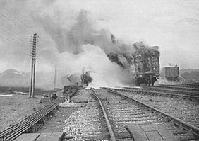 Burning carriage in the aftermath of the collisions