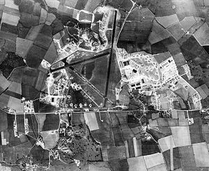 RAF Alconbury - Aerial Photograph of RAF Alconbury to the left (west) and the 2d Strategic Air Depot to the right (east) of the photo taken on 9 May 1944. Note the station area of Alconbury south of the A14 and the bomb dump to the north of the airfield. This is what the facility looked like at the conclusion of the war when it closed in late 1945.