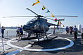 ROCN Hughes 500 6910 Carried on Lan Yang (FFG-935) Helicopter Deck Front Left View 20141123.jpg