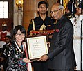 Ram Nath Kovind presenting the Nari Shakti Puruskar for the year 2017 to Ms. Thinlas Chorol, Leh-Ladakh, J&K, at a function, on the occasion of the International Women's Day, at Rashtrapati Bhavan, in New Delhi.jpg