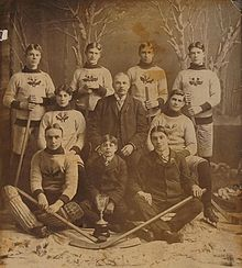 An early ice hockey team poses for a photo.