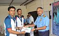 Rear Admiral Ajendra Bahadur Singh awarding prizes to the winners of the Navy Open Enterprise Class Yachting Championship 2014-15 (2).jpg