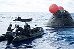 Recovery team arrives at Orion capsule after EFT-1.jpg