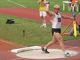Remigius Machura preparing to throw within the circle - Track and field