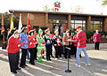Retired U.S. Col. Bryant, right, leads the Christmas carols, during a ceremony, at the Christmas House charity, in Fort Gordon, Ga., Nov. 30, 2009 091130-A-NF756-001.jpg