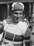 Rik Van Looy wearing a cycling cap with Faema insignia and a white cycling jersey with horizontally rainbow stripes across the chest