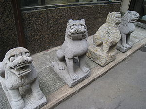 "Dog in Chinese mythology - Chinese stone statue of ""lions"", showing pronounced dog-like features"