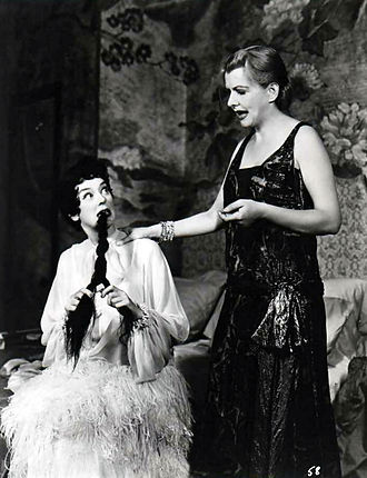 Rosalind Russell - Rosalind Russell (left) and Polly Rowles in the original Broadway production of Auntie Mame (1957)