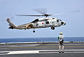 SH-60J (24-8277) of JMSDF lands on the flight deck of USS George Washington, -22 Jun. 2012 a.jpg