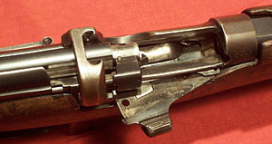 Bolt action - Close-up of the action on an SMLE Mk III rifle, showing the bolt-head, magazine cut-off, and charger clip guide.