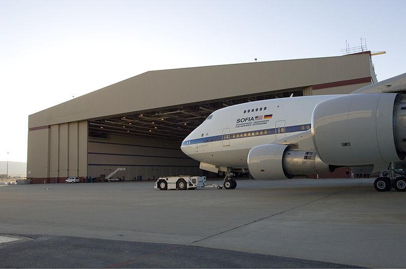 File:SOFIA is towed into a hangar by a tug.jpg