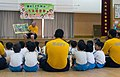 Sailor reads to Japanese kindergarten students during a visit to a local school. (35389396954).jpg
