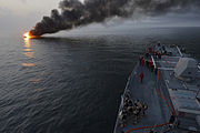 Sailors aboard the guided-missile destroyer USS William P. Lawrence (DDG 110) prepare to offer rescue assistance to a burning vessel during a transit of the Strait of Hormuz on March 11, 2013 130311-N-ZQ631-124