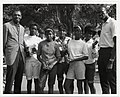 Sam Jones and Satch Sanders of the Boston Celtics stand with girls holding basketball trophies (13561806333).jpg
