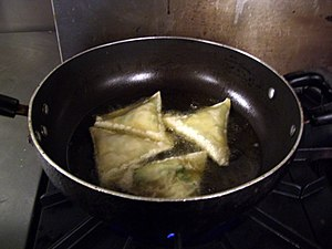 English: Somali sambusas (samosas) being deep ...