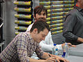 San Diego Comic-Con 2011 - Elijah Wood and Jason Gann from Wilfred sign for fans (Fox booth) (5976792377).jpg