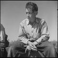San Joaquin Valley, California. Contract Labor. From Oklahoma, 22 years old. With idle hands, he sits in the sun of... - NARA - 532162.tif