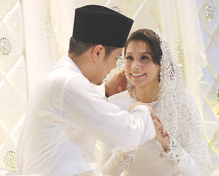 Awal on his wedding day with Scha