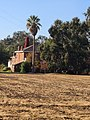 Scully Ranch--south side street view of house.jpg