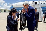 Secretary Kerry Bows as he Greets a Laotian Protocal Officer at the Wattay International Airport in Vientiane (27919158043).jpg