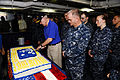Secretary of the Navy Ray Mabus cuts a cake in honor of his visit to the aircraft carrier USS Enterprise (CVN 65) while in the Arabian Sea Aug. 6, 2012 120806-N-FI736-210.jpg