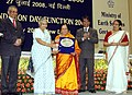 Sheila Dikshit giving away the National Award for lifetime contribution in the field of Atmospheric Science & Technology to Prof. Sulochana Gadgil, at the Foundation Day Function of the Ministry of Earth Sciences.jpg