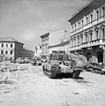 Sherman and Churchill tanks in the main square of Portomaggiore, Italy, 20 April 1945. NA24367.jpg