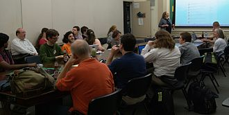 The Signpost - Wikipedia community members working on The Signpost at a conference in New York City, 2009