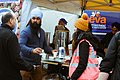 Sikhs distributing langar (free food) in London.jpg