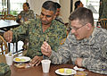 Singapore Armed Forces and US soldiers share the tradition of tea time 120711-A-VA075-279.jpg